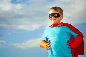 child playing at being a hero